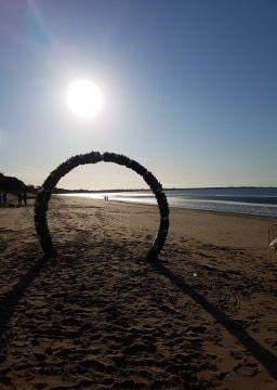 Circle Arch on a sunset beach