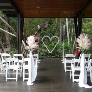 Simple white wedding arbour
