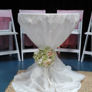 Round signing table with flowing cloth and sash