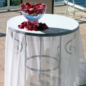Round wrought iron registry table with sheer white overlay