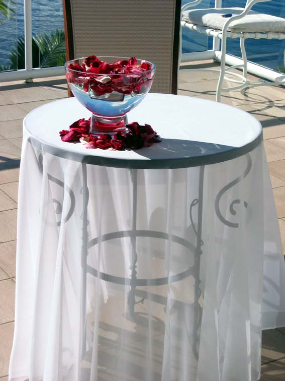 Round wrought iron signing table with sheer white overlay